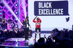 ATLANTA, GA - MARCH 03: D.C. Young Fly and Jess Hilarious speak onstage during the 2019 BET Social Awards at Tyler Perry Studio on March 3, 2019 in Atlanta, Georgia. (Photo by Bennett Raglin/Getty Images for BET)